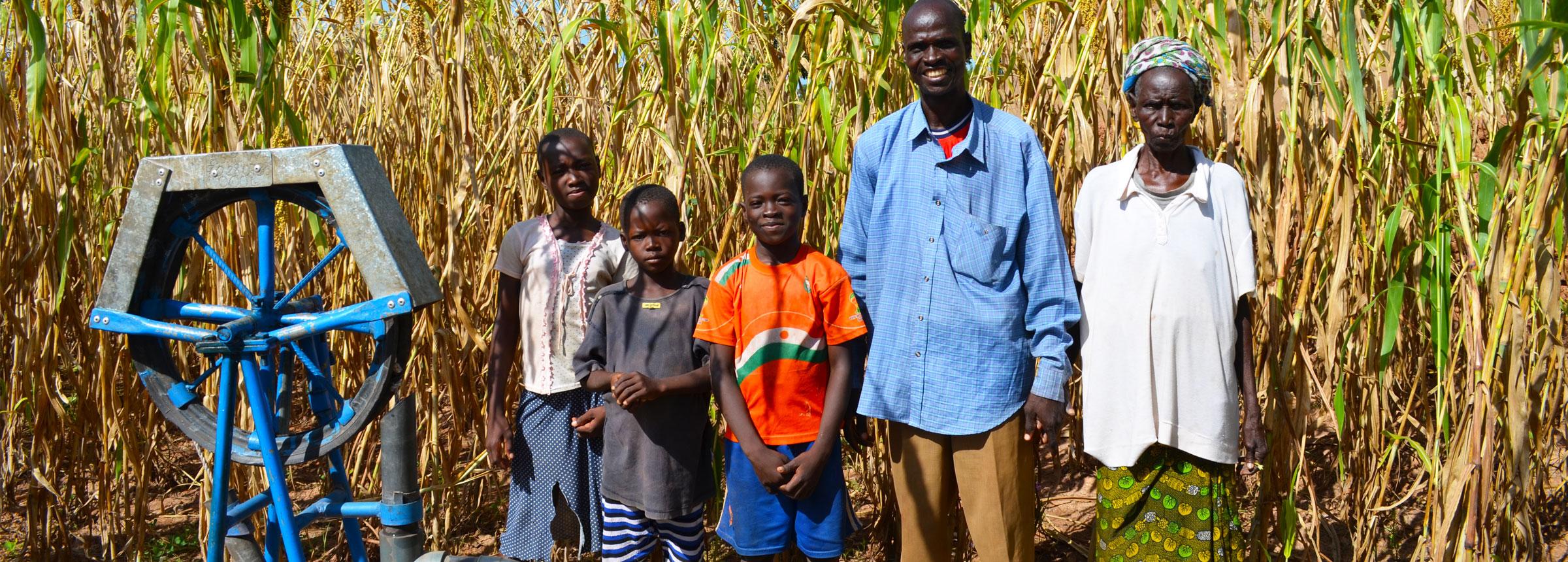 Burkina Faso family at water pump