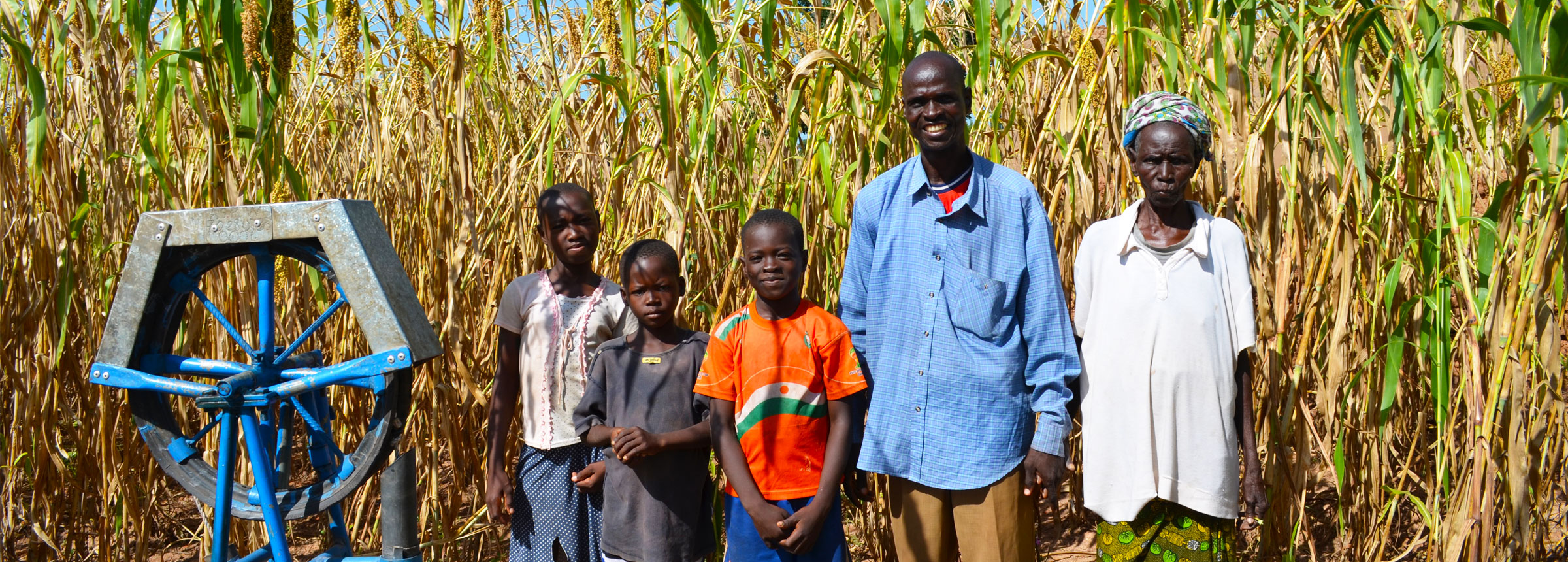 Burkina Faso family at water pump