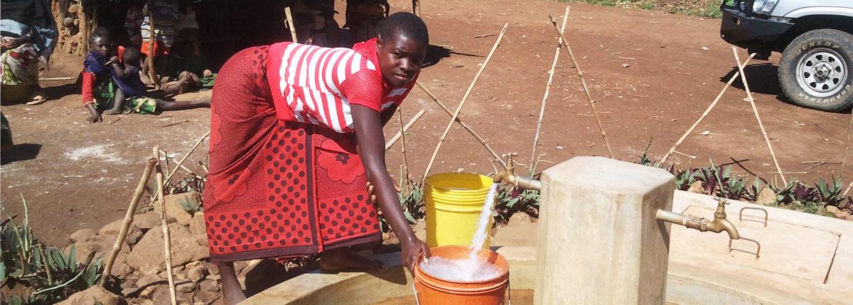 Tanzanian woman at water point