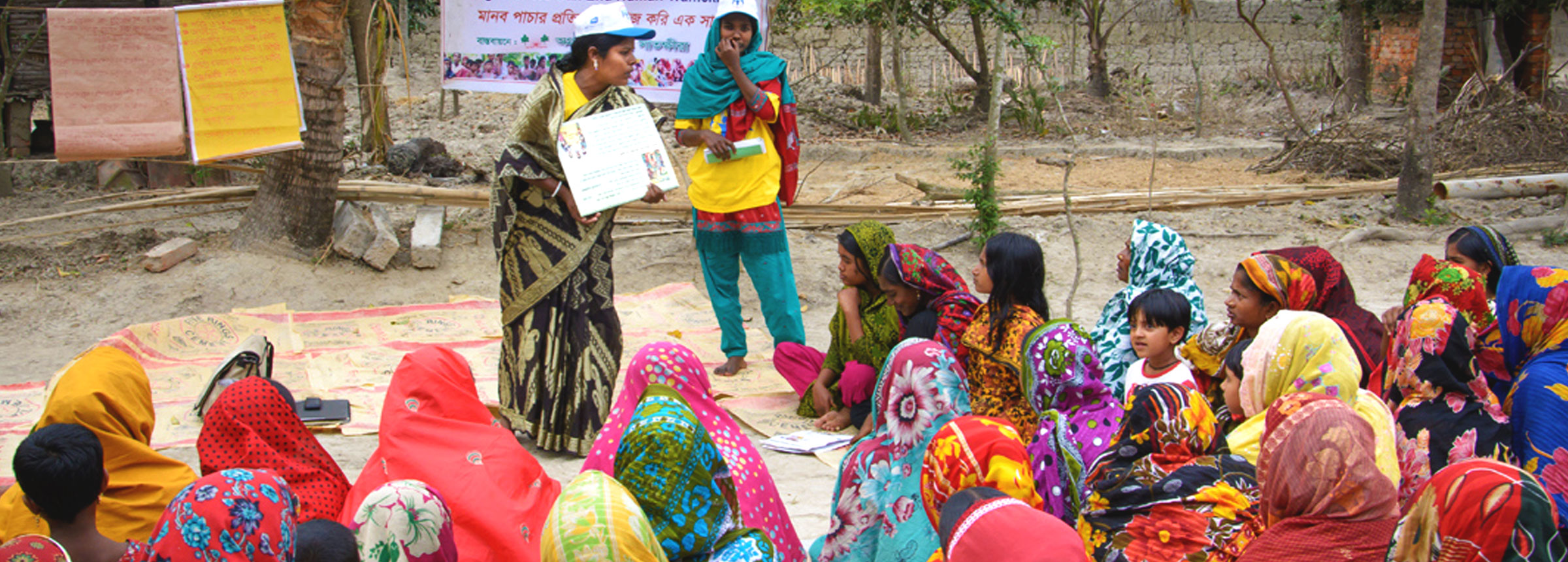 Anti-trafficking trainer addressing group of Bangladeshi women