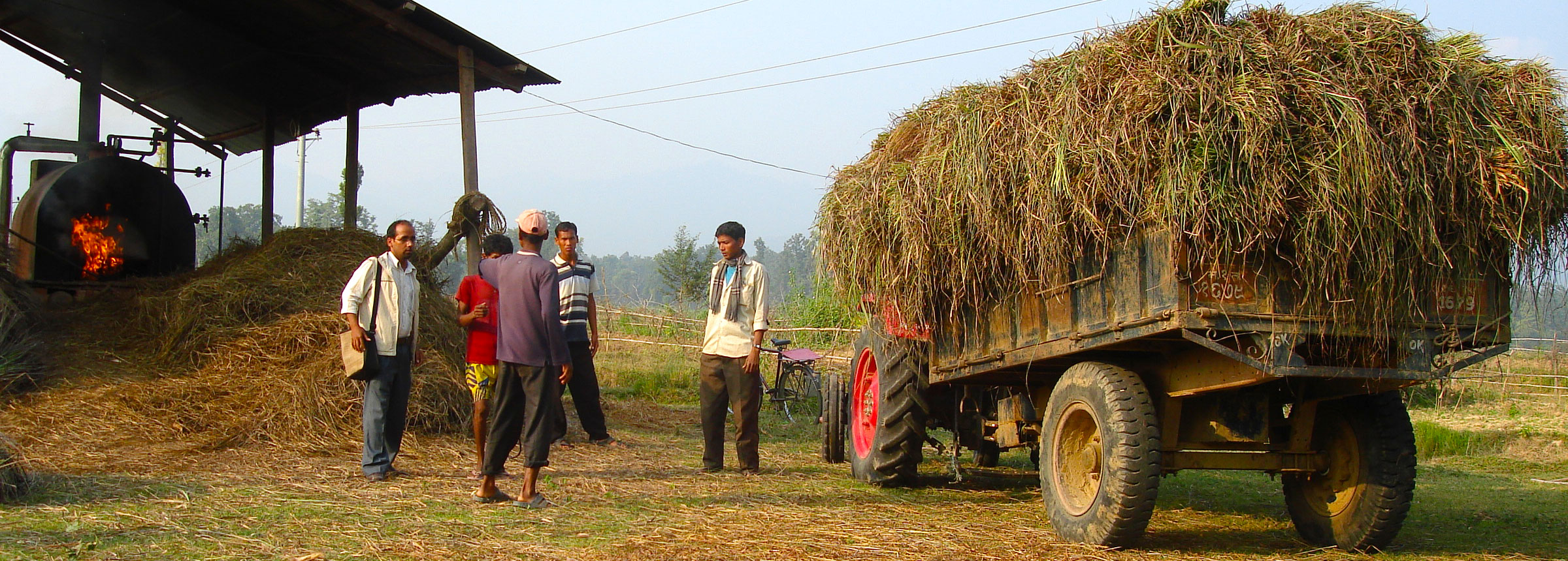 Nepali farmers offloading hay from truck