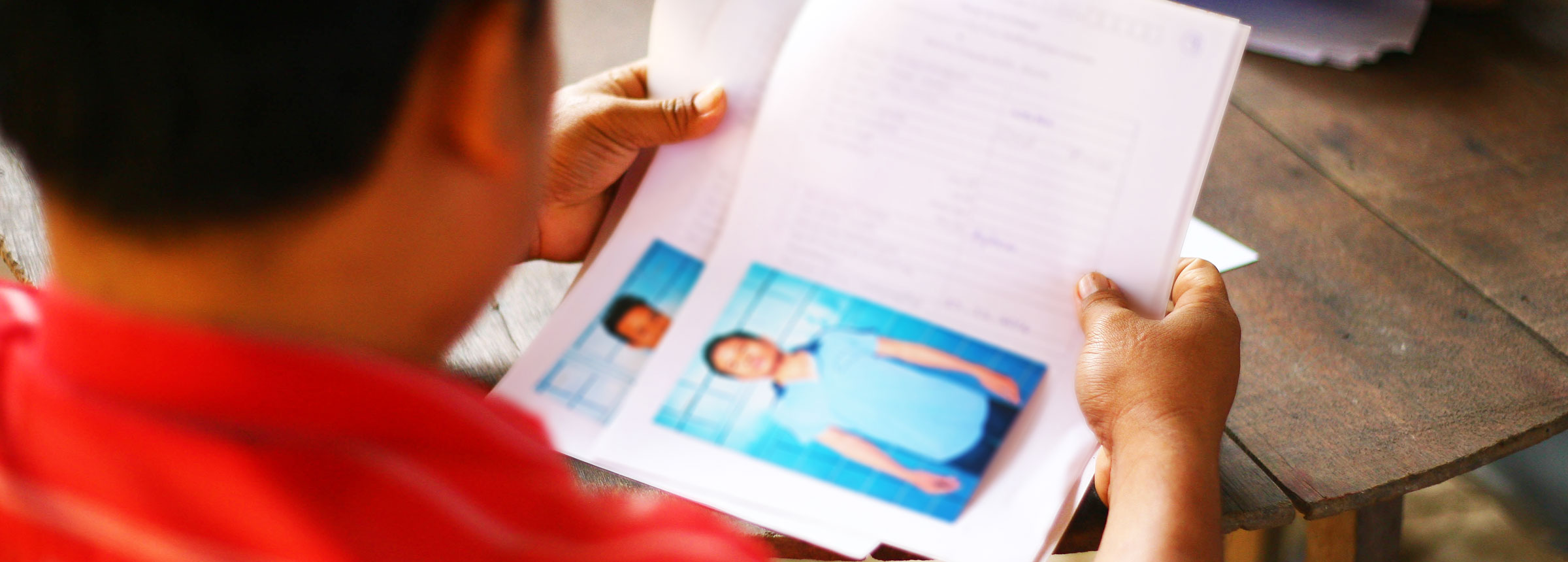 Anti-trafficking officer looking through ID documents