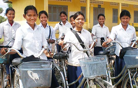 A group of young girls on bicycles