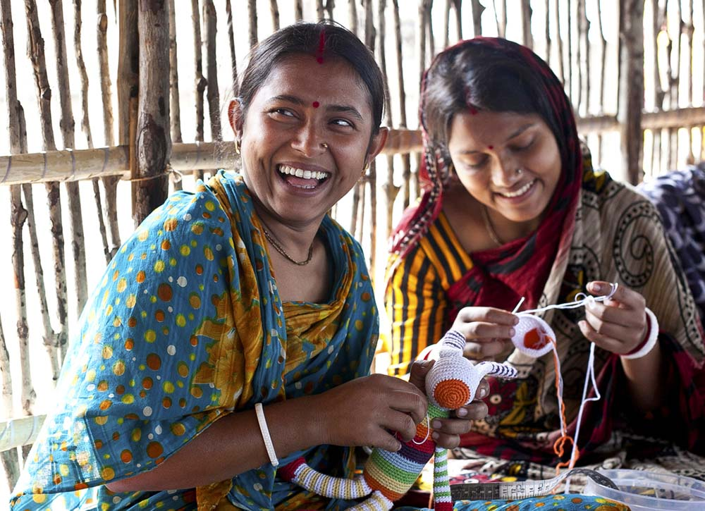 Two women in Bangladesh create handmade toys.