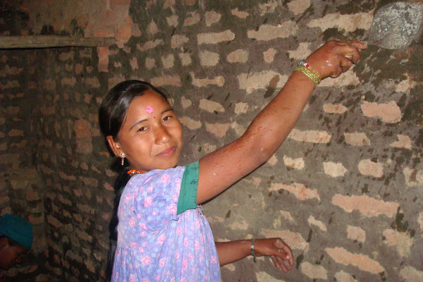 After years of servitude, Ram Kumari Chaudhary enjoys her job as a mason, which brings income and empowerment.