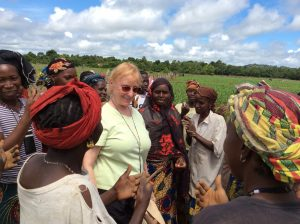 F2F volunteer Edie Shannon with women's association members in Guinea