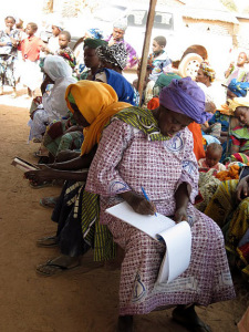 women's cooperative members take notes during Farmer-to-Farmer training