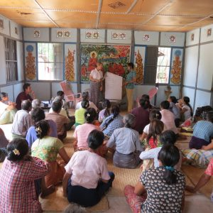 F2F volunteer Halina Zaleski presents to a rapt audience in Myanmar