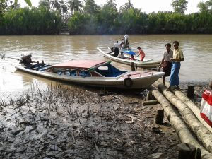 students loading onto a boat