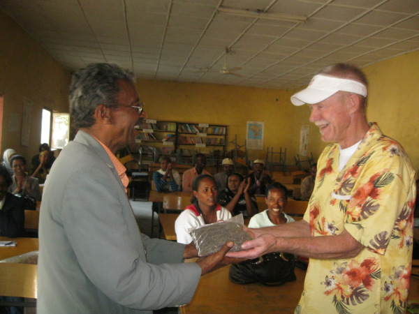 Volunteer Doug Johnson receives gift from host in Ethiopia