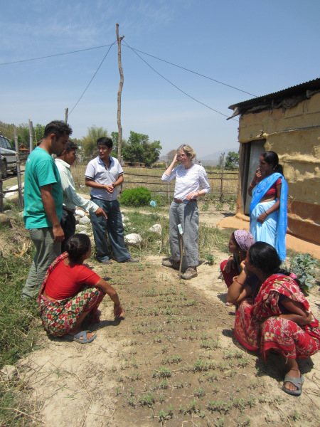 Amar in the field with a volunteer and trainees