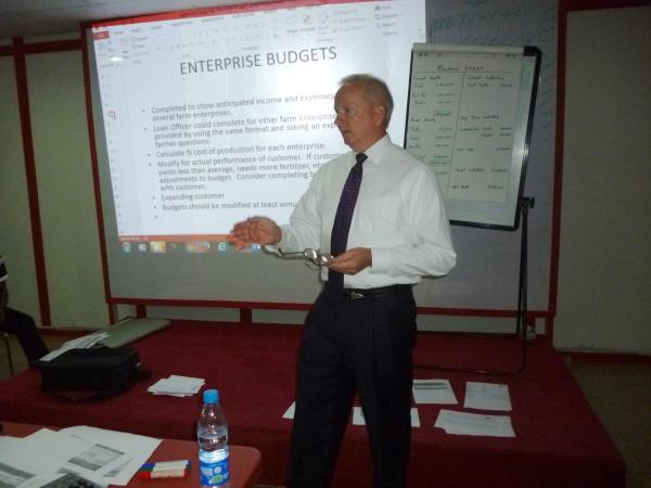 Farmer-to-Farmer volunteer Bob Bonnet teaches Hasal Microfinance Bank  loan officers about agricultural lending