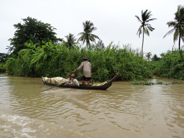 Local farmers transporting their harvest up the river