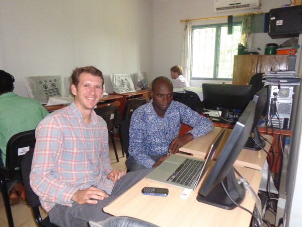 Quinn with AEMIP Monitoring and Evaluation Specialist Laye Oulare