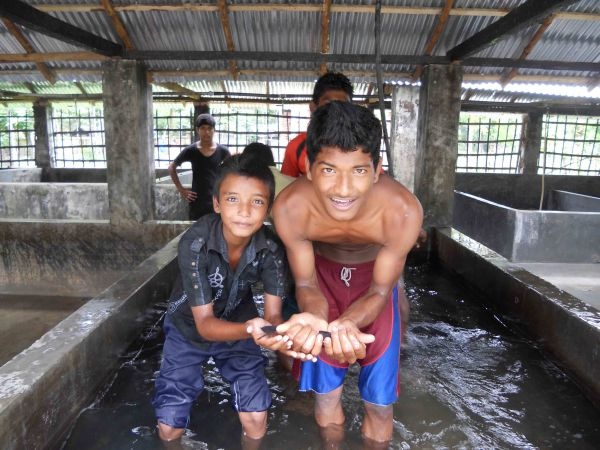 Fish hatchery workers show off their hard work