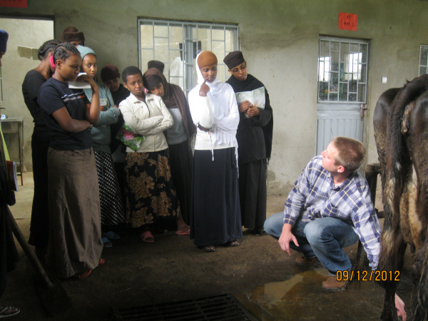 Volunteer Hans Schmitz talks with Sebeta Getesemani Nunnery/Orphanage staff and youth about improved dairy practices