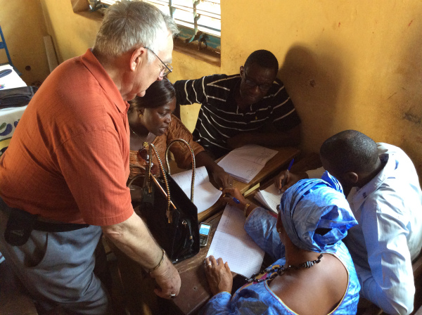 Bob works with a small group of trainers from the poultry farming organization