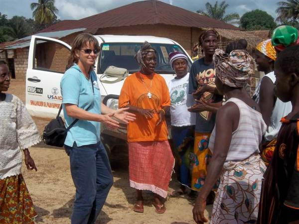 Volunteer Kevyn Wightman greeted by village farmers