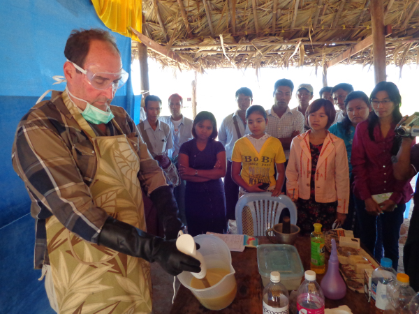 F2F volunteer Robert Spencer demonstrates soap-making to villagers in Twintaw. (Photo Credit: Dr. Thet Khaing, Winrock International)