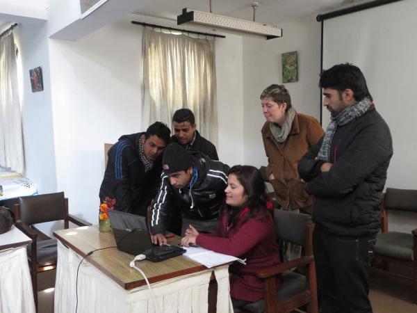 Trainees hard at work, under the guidance of volunteer Susan Pavlin