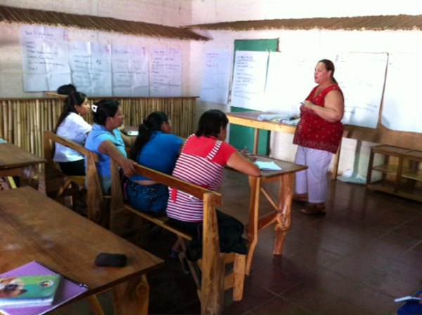 Volunteer Quanah Stamps trains a group of women farmers in El Salvador