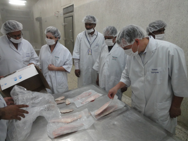 Inspecting fish processing activities at Rupsha Fish & Alllied Industries