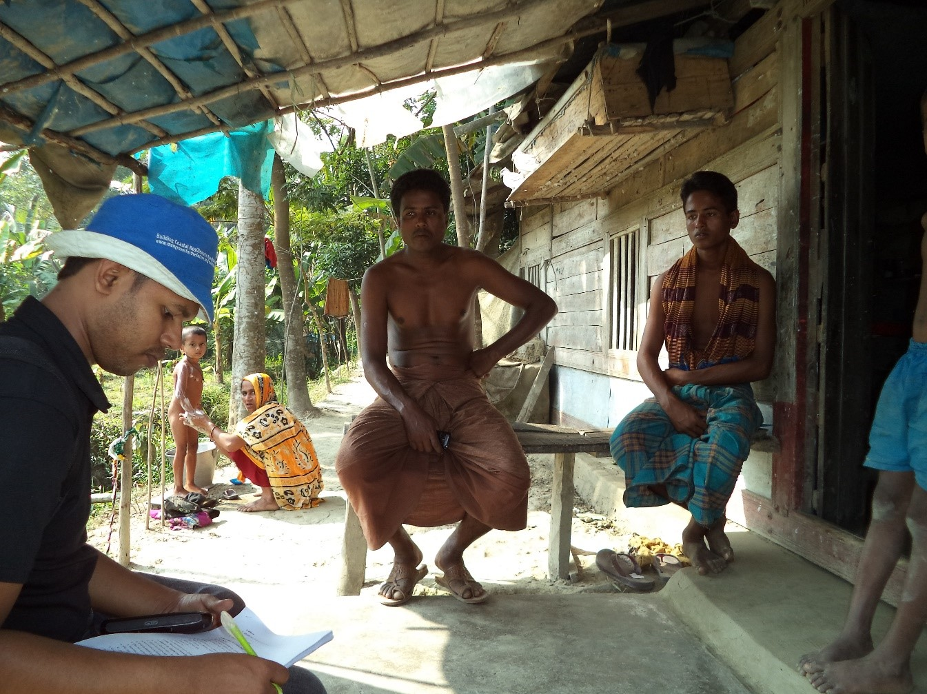 The CREL/JDR 3RD Mangrove Valuation team interviews residents of Sharankhola county, Khulna District, to understand how they use Sundarbans mangrove resources as part of their livelihoods