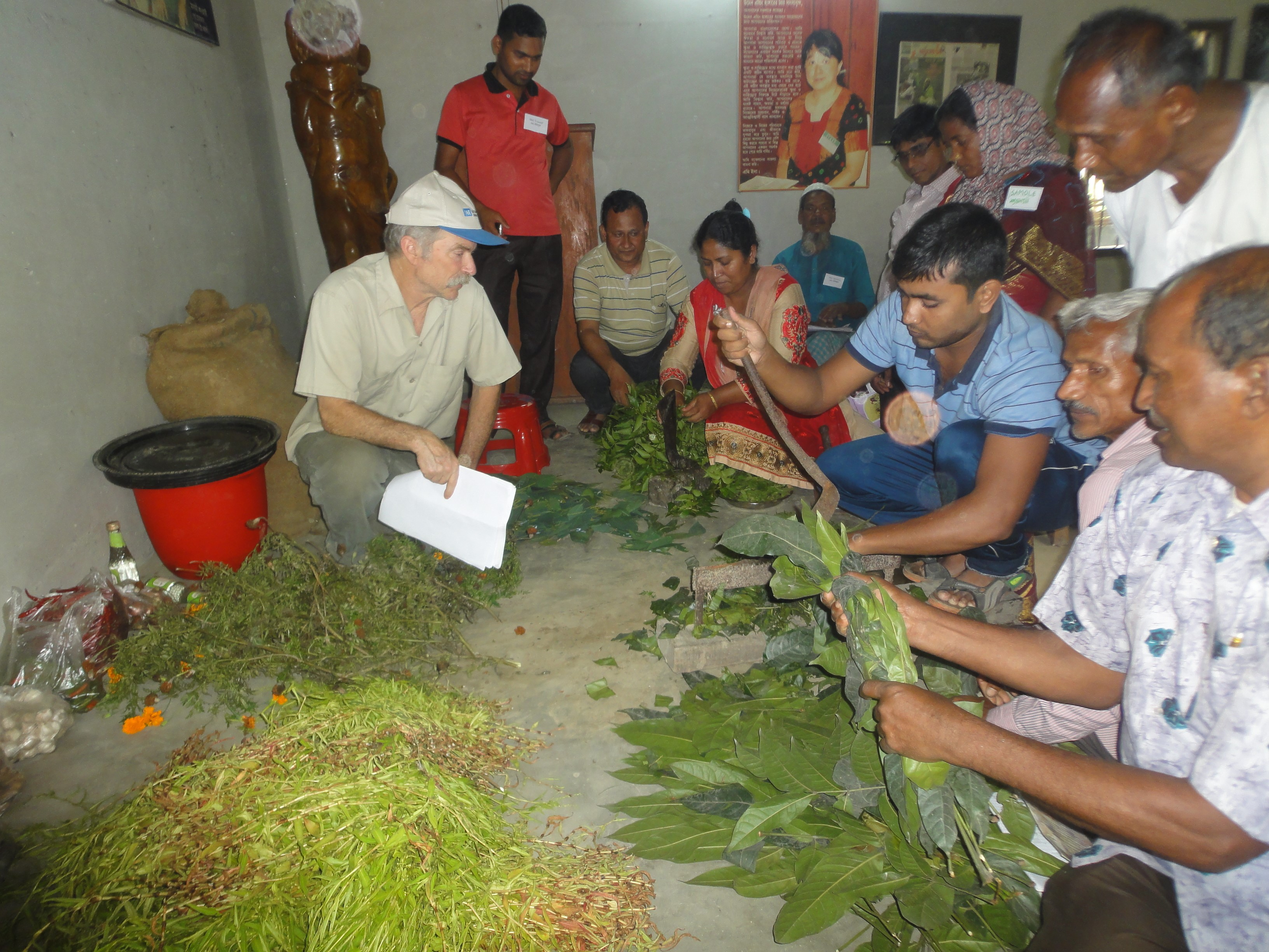 Charles Mitchell giving instructions on how to prepare an insect repellent using organic ingredients and various plant leaves to spay any kind of plant or crop to control insects.