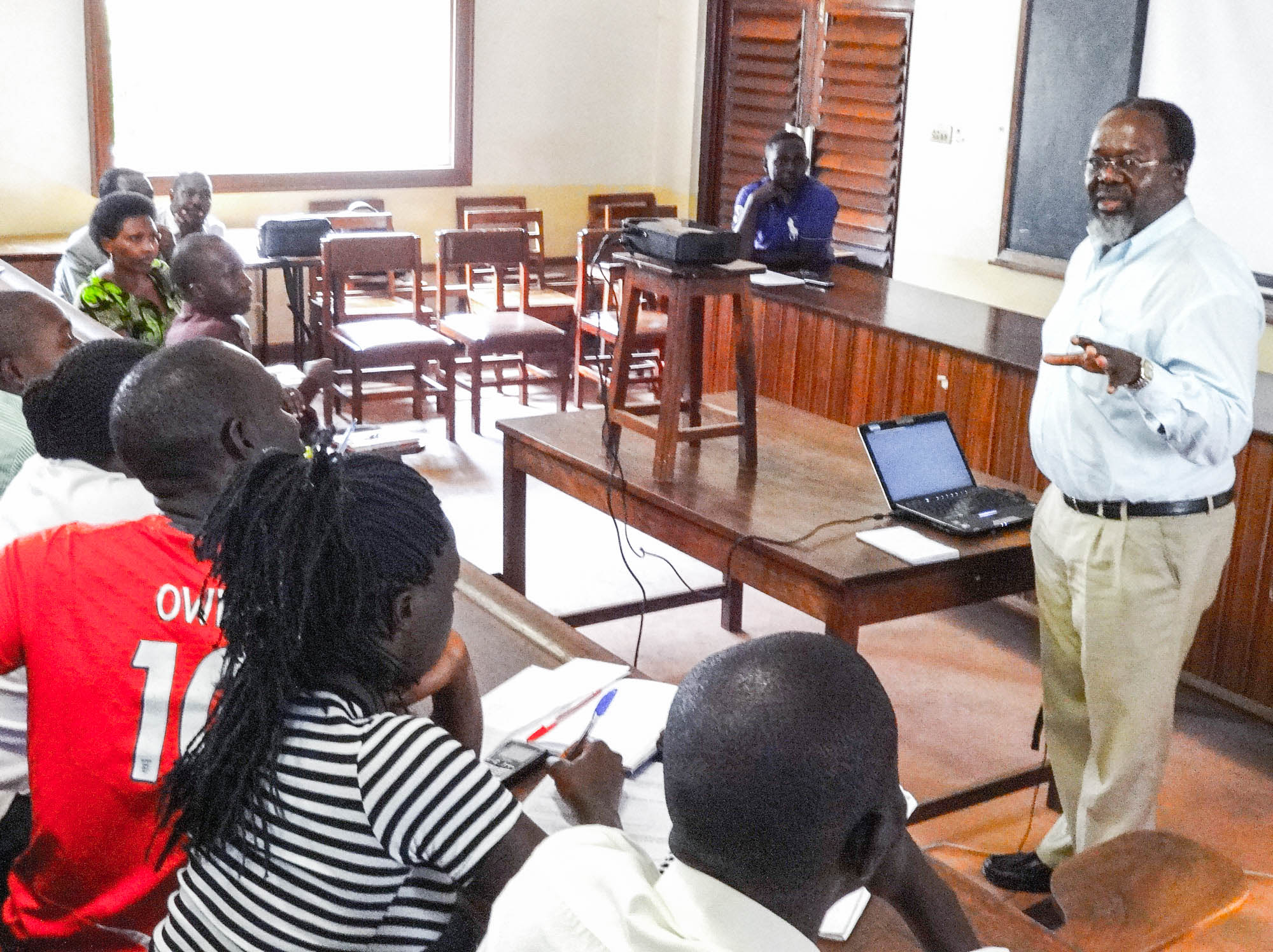 Mutimba teaching agricultural extension agents at Makerere University in Uganda. Mutimba oversees SAFE program activities at 11 universities in East Africa.
