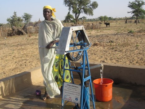 Ali's wife Nanuwa at their local rope pump.