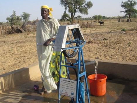 Ali's wife Nanuwa at their local rope pump.