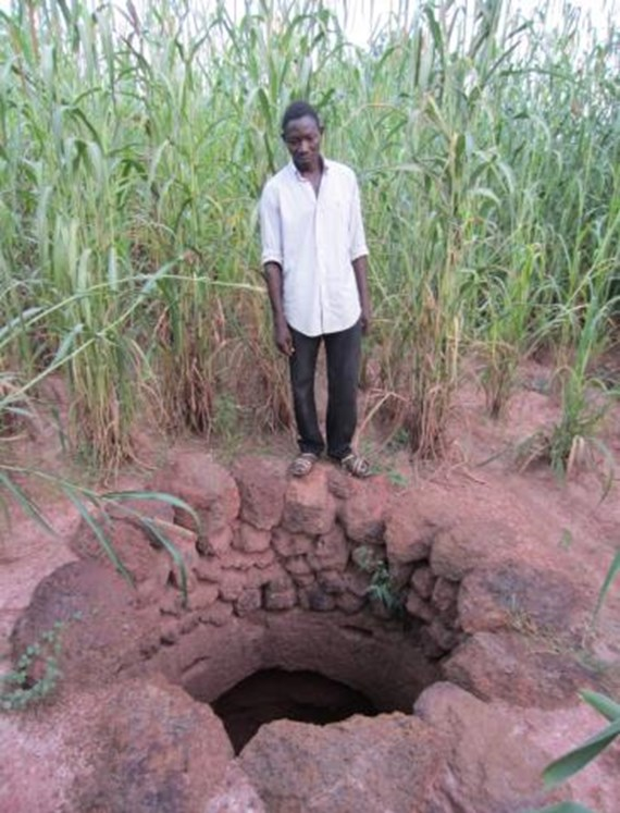 Before: Mr. Zongo hand-dug this well hoping to provide for his family's water needs but, without training on techniques for reinforcing well walls, his efforts collapsed.