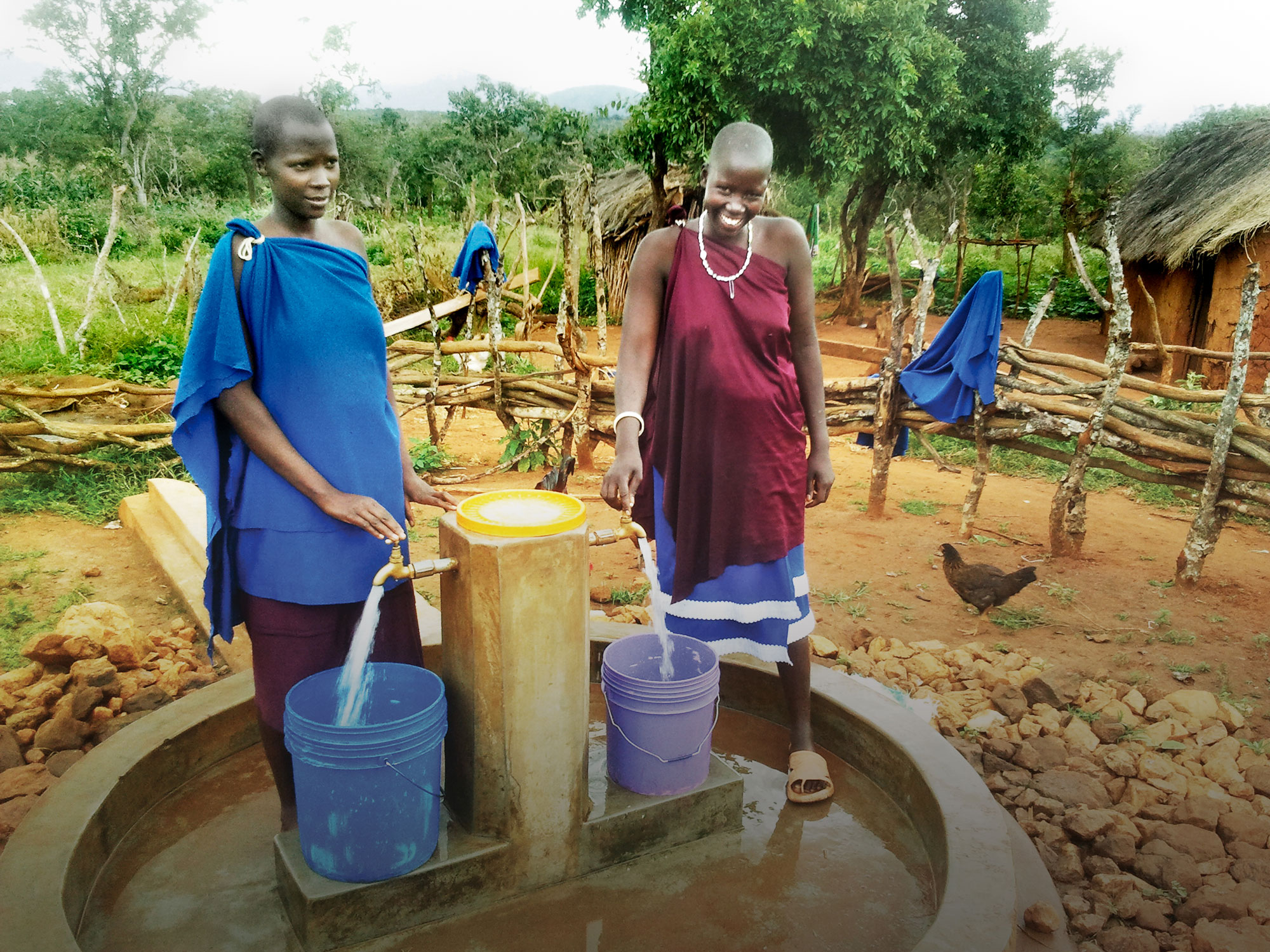 Sarai Jacobi of Nyakonge, Tanzania, right, by the new pump that brings water to her village.